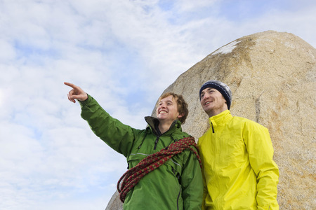 Portrait of 2 climbers, one pointing LANG_EVOIMAGES