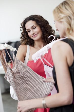 resolving: women looking at dress