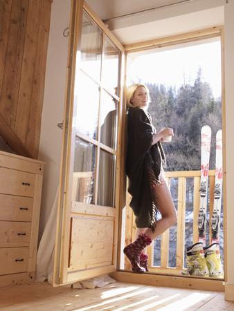 easygoing: woman standing in balcony door
