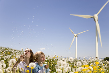in twos: Girl and boy at wind turbine LANG_EVOIMAGES