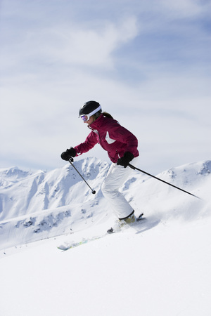 Woman in red & white outfit off-piste.