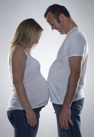 affiliation: pregnant woman comparing bump with man