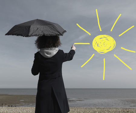 affiliation: Woman painting sun onto grey sky