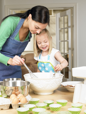 stir up: Mother and daughter cooking