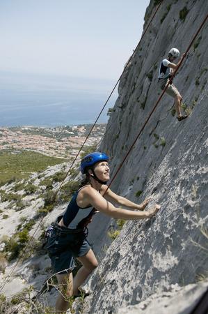 unafraid: Woman rock climbing