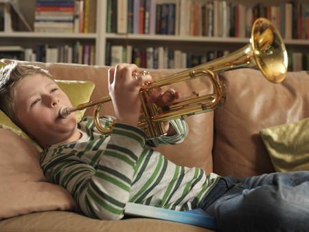Boy, 11 playing trumpet