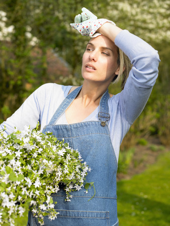 summers: Woman holding a flower pot