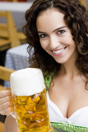 Young Woman With Glass of Beer LANG_EVOIMAGES
