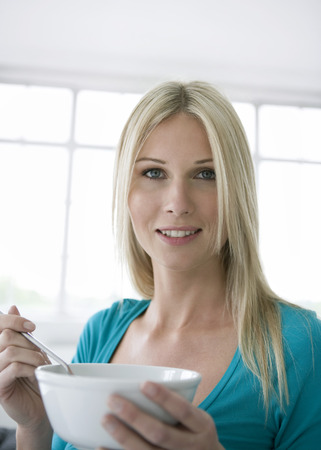 Portrait of woman holding a bowl.