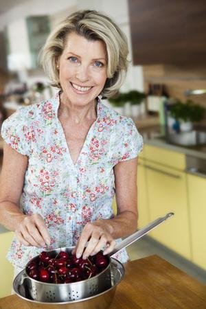 Senior Woman sorting Cherries