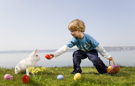 boy, bunny finding easter eggs LANG_EVOIMAGES