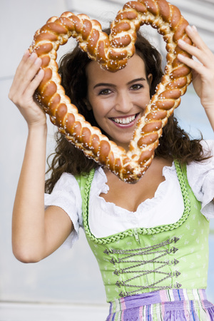 Young Woman With Pretzel Heard LANG_EVOIMAGES