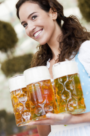 Young Woman With Glasses Of Beer LANG_EVOIMAGES