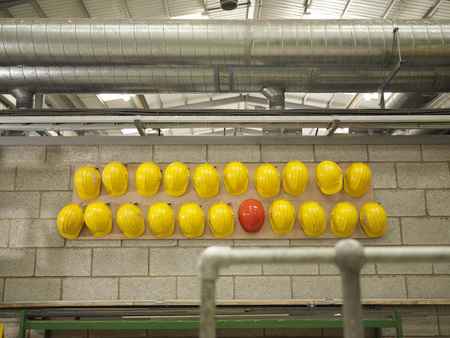 conforms: Rows Of Yellow And Red Hard Hats