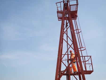 defended: Crane Worker High Up On Crane LANG_EVOIMAGES