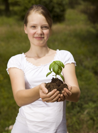 enthusiastically: girl with basil plant LANG_EVOIMAGES
