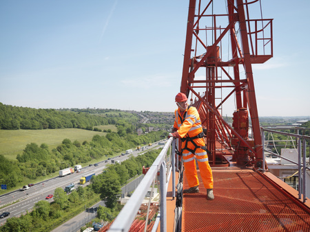 carriageway: Crane Worker On A Crane LANG_EVOIMAGES