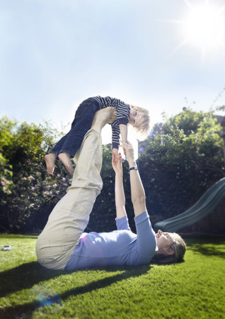 reaches: Young boy with mother