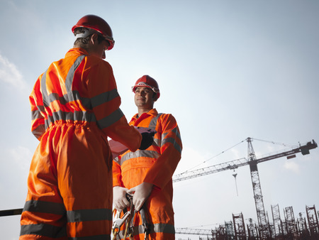 Workers With Notes And Cranes