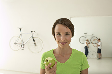 woman with green apple