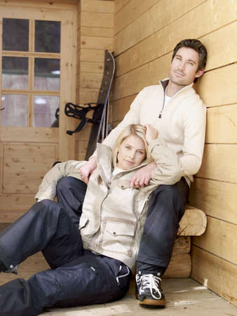 beau: man and woman sitting outside chalet LANG_EVOIMAGES