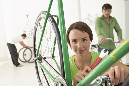 woman repairing bike