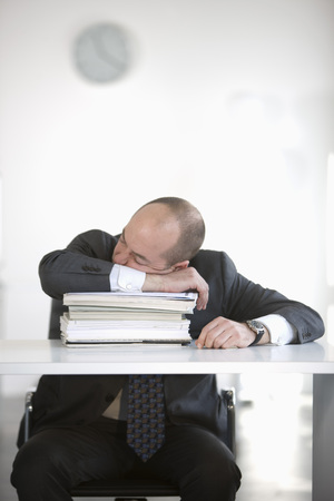 struggled: man is sleeping in office