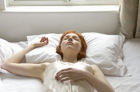lays down: woman asleep on bed