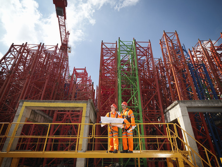 Crane Workers With Plans