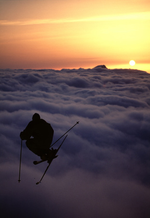 Silhouette of a skier jumping.