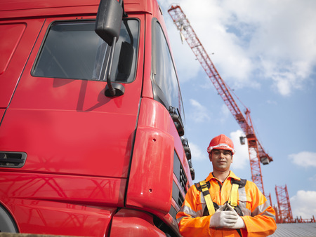 Crane Worker Next To Lorry