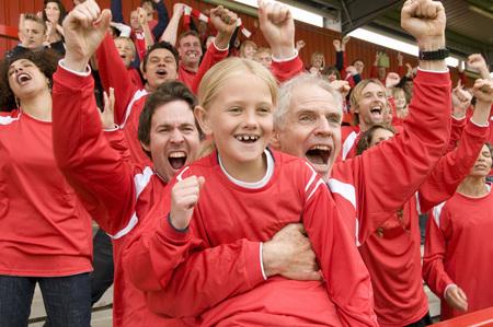 shrieking: Fans celebrating at football match LANG_EVOIMAGES