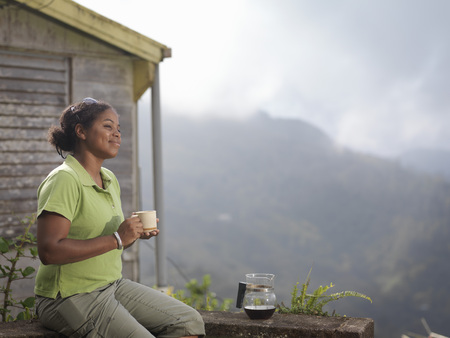 refreshed: Female Coffee Worker Drinking Coffee LANG_EVOIMAGES