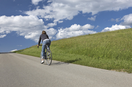 Woman bicycling in the countryside