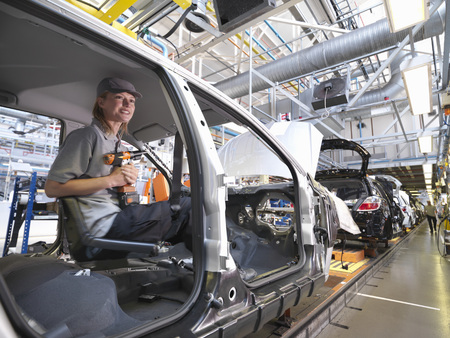 assembled: Female Car Worker On Production Line