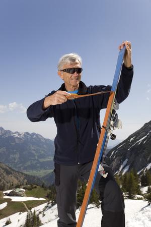 senior man on ski tour in mountains LANG_EVOIMAGES