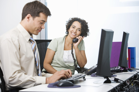 conferring: A senior business woman at work LANG_EVOIMAGES