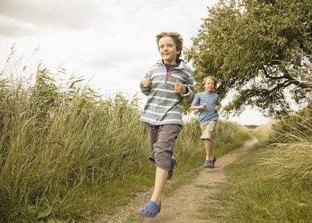 pursued: Boys running down path