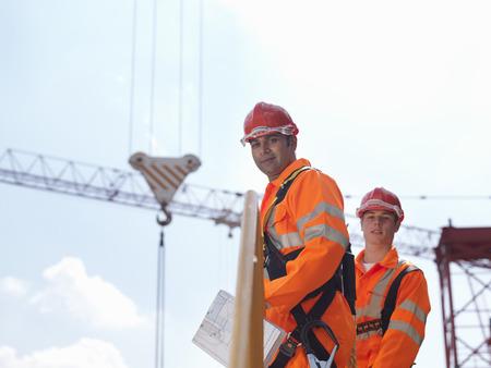 Crane Workers In Front Of Cranes