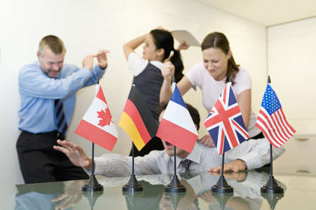 disagreeing: A business group fighting behind flags
