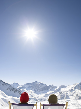 man and woman on deck chair up mountain LANG_EVOIMAGES