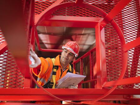 Crane Worker Inspecting Crane LANG_EVOIMAGES