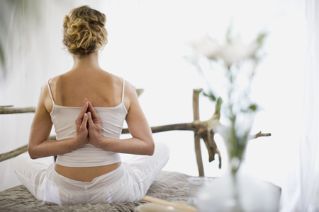 spiritual beings: middle-aged woman doing yoga