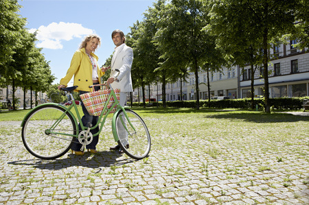 Two people with bicycle in conversation