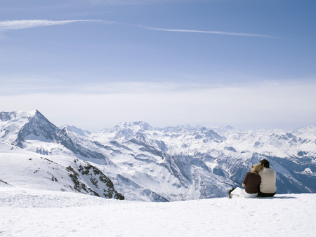 man and woman looking out from mountain
