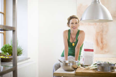 carryall: mother in kitchen