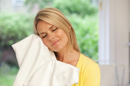 yielding: Beautiful young housewife doing laundry