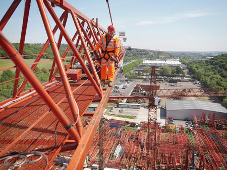 Crane Worker Walking Along Crane LANG_EVOIMAGES