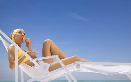 munching: woman lying in a sun lounger