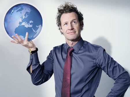 interrogations: Business man holds up globe